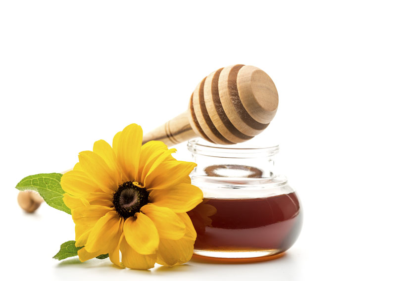 Fresh honey in a jar and honey dipper